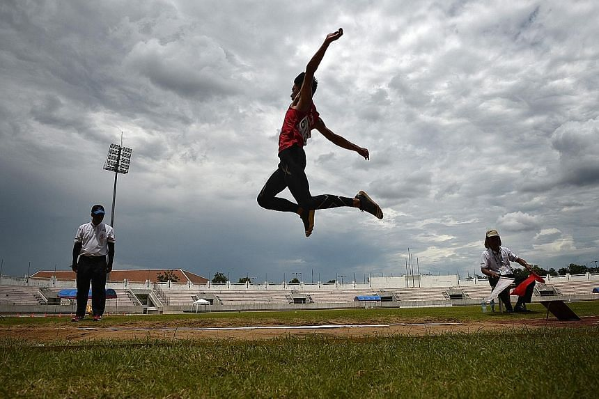 Singaporean Joseph Zhao in action during the Asean Schools Games long jump final. He won gold with a 6.70m effort.