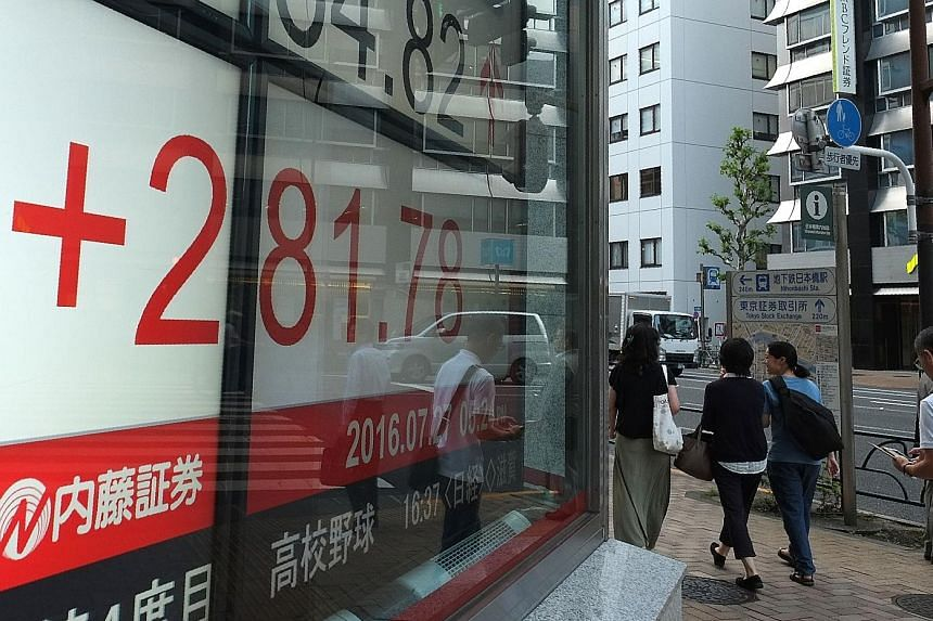 Tokyo stocks ended higher yesterday after Japanese Prime Minister Shinzo Abe announced a whopping 28 trillion yen (S$361 billion) fiscal stimulus package aimed at kickstarting the country's faltering economy.