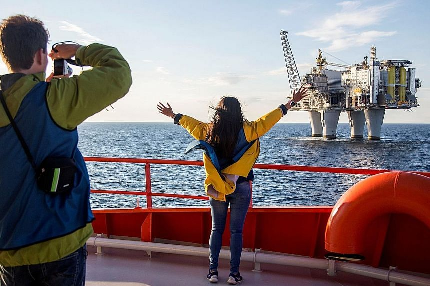 A group of 120 tourists, almost all Norwegians, each paid between $950 and $4,750 for four days on board an offshore vessel for a tour of some of the country's oil rigs - the first such tour ever.