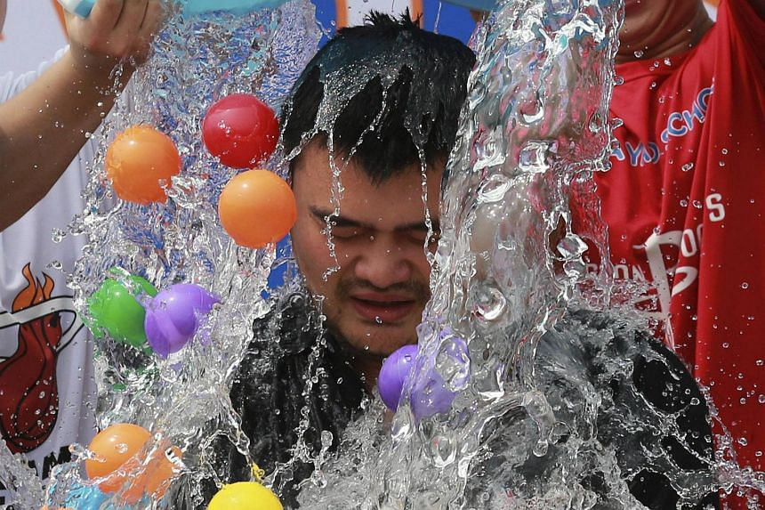 Former NBA star Yao Ming taking part in the ALS ice bucket challenge in Beijing on Aug 23, 2014.