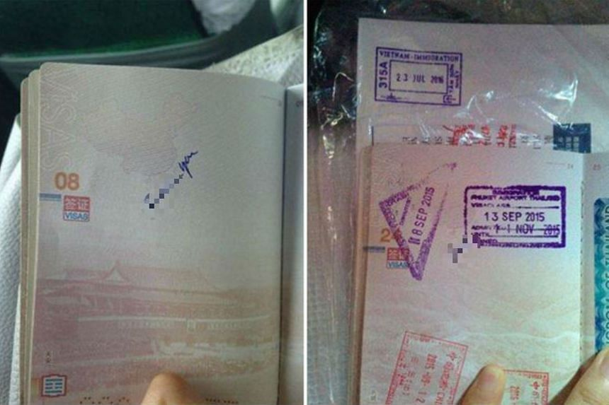 Vulgarities that were scribbled onto a Chinese woman's passport by immigration officials in Tan Son Nhat International Airport in Ho Chi Minh City. The words are written along an image of China's nine-dash line.