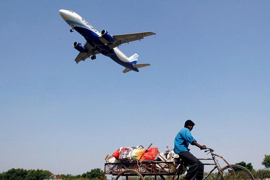 An IndiGo Airlines aircraft prepares to land in Ahmedabad, India, on Oct 26, 2015.