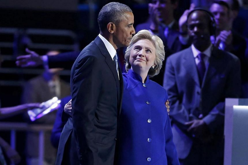 Democratic presidential nominee Hillary Clinton (right) joins President Barack Obama after his speech at the Democratic National Convention in Philadelphia.