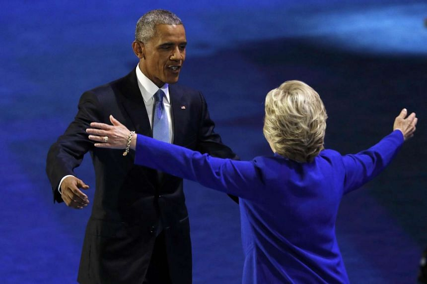 US President Barack Obama (left) greets Democratic presidential nominee Hillary Clinton at the Democratic National Convention in Philadelphia.