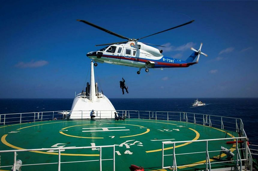 Helicopter rescue crew members practise rescue techniques at an emergency drill by Sansha city's maritime search and rescue centre in the South China Sea near Sansha, on July 14, 2016.