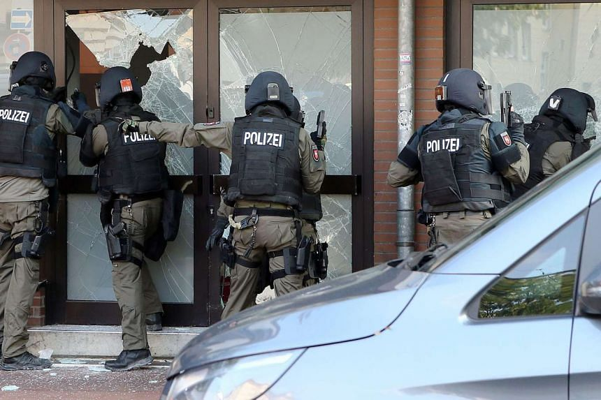 Police officers participate in an operation in Hildeshein, Germany, on July 27, 2016.