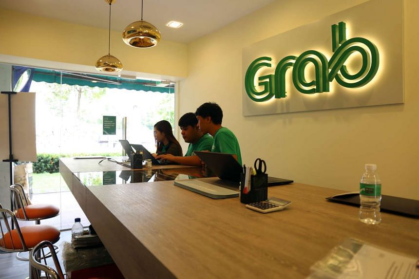Grab Employees at the new GrabTaxi Driver Support Centre in Jurong East.