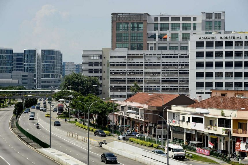 New industrial buildings (left) stand in contrast against old industrial buildings and shophouses (right) along Upper Paya Lebar Road.