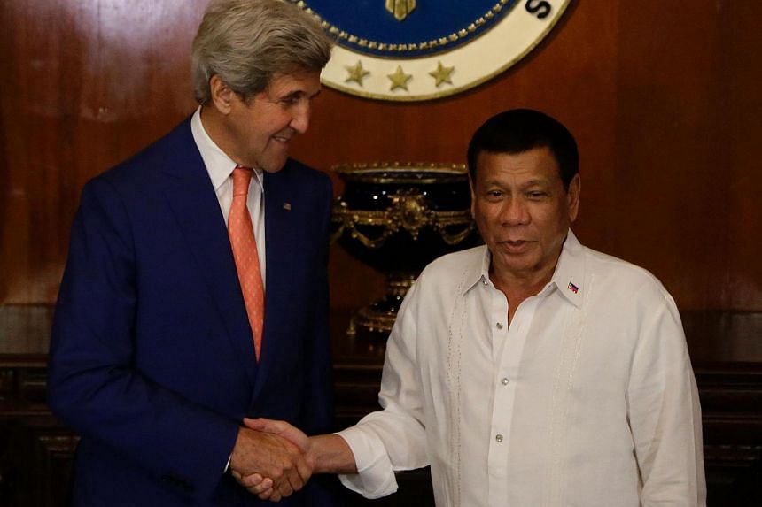 Philippine President Rodrigo Duterte (right) shakes hands with US Secretary of State John Kerry during his visit to the Malacanang presidential palace in Manila on July 27.