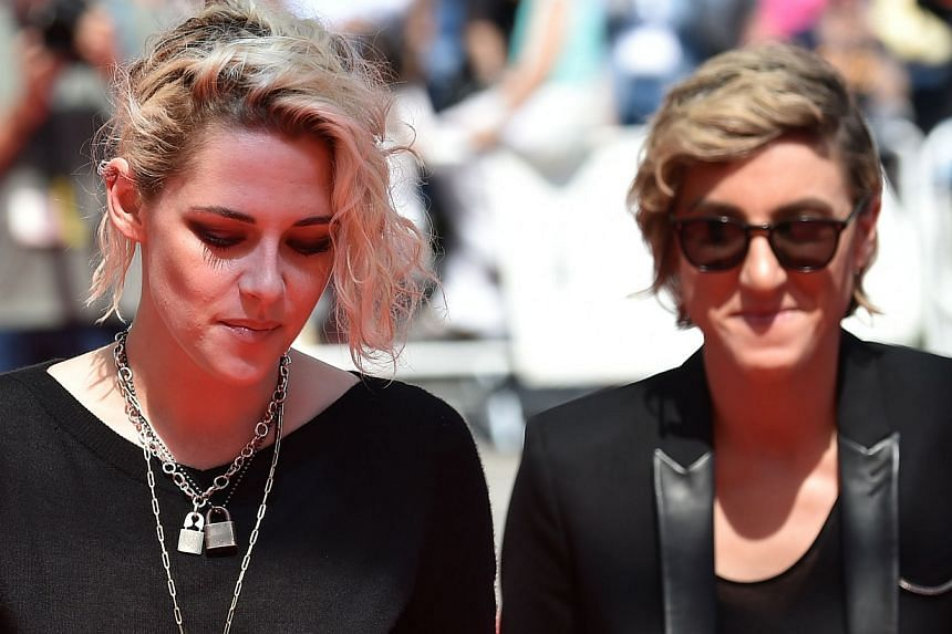 Actress Kristen Stewart (left) and visual effects producer Alicia Cargile arrive on May 15, 2016, for the screening of American Honey at the 69th Cannes Film Festival in Cannes.