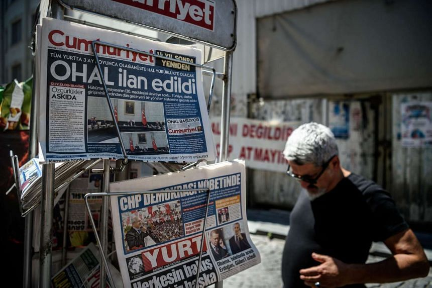 Newspapers with headline '3 months state of emergency' near a shop on July 21, 2016 in Istanbul, following the failed military coup attempt of July 15.