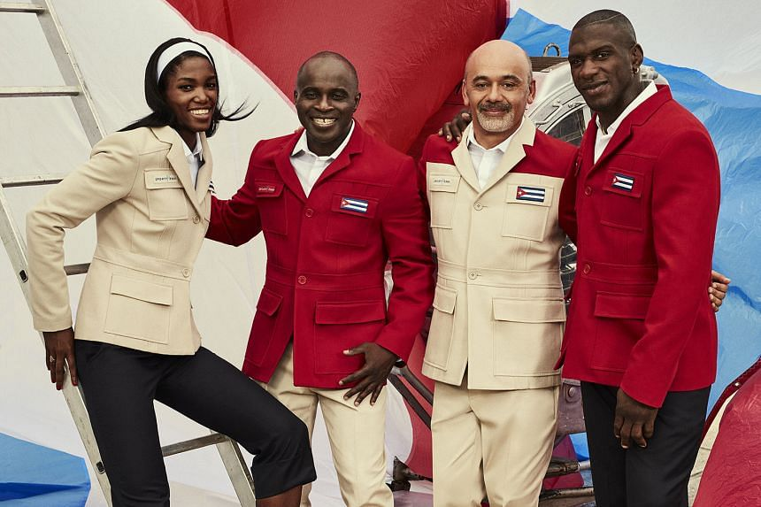 Cuban athletes Lidianny Echeverria Benitez and Javier Cortina Lacerra with Sporty Henri founder Henri Tai (second from left) and Christian Louboutin (third from left).