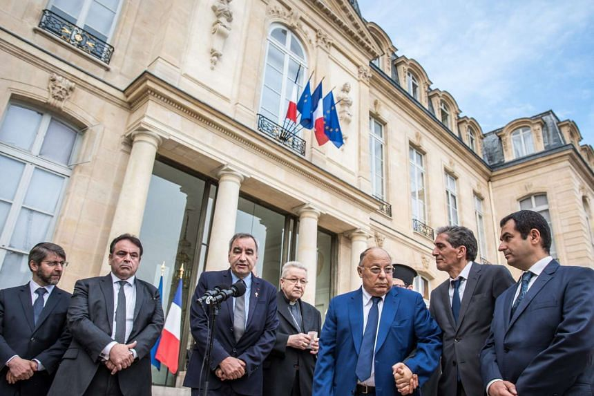 French Protestant leader Francois Clavairoly (third from left) speaking to journalists at the Elysee Palace. With him are the Archbishop of Paris, Cardinal Andre Vingt-Troi (fourth from left), Muslim leader Dalil Boubakeur (third from right) and Jewi