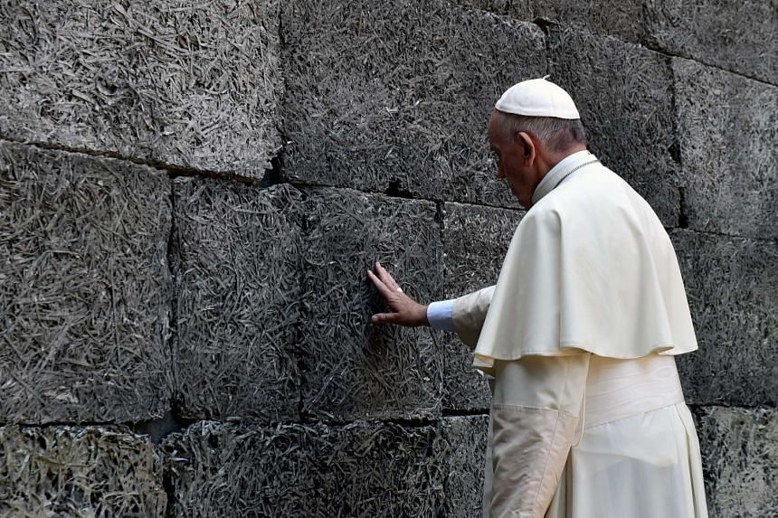 Pope Francis prays at the Death Wall in the former Former Nazi German concentration camp KL Auschwitz I in Oswiecim, on July 29, 2016.