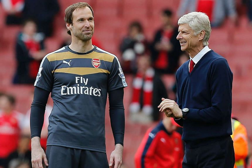 Arsenal's Czech goalkeeper Petr Cech (left) stands with manager Arsene Wenger after the EPL football match between Arsenal and Aston Villa on May 15, 2016.