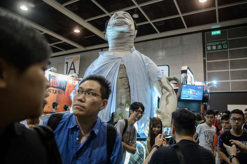 """A statue based on local politician Christopher Chung is displayed at the stall of a virtual reality game """"Hong Kong Infected"""" at the Ani-Com show on July 29, 2016."""