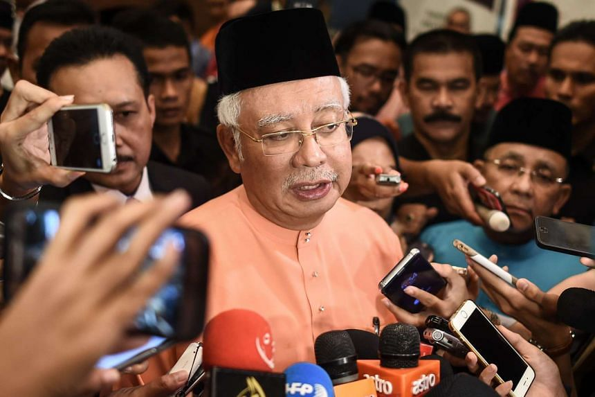 Malaysia's Prime Minister Najib Razak speaks to the media after an event in Kuala Lumpur, on July 21, 2016.