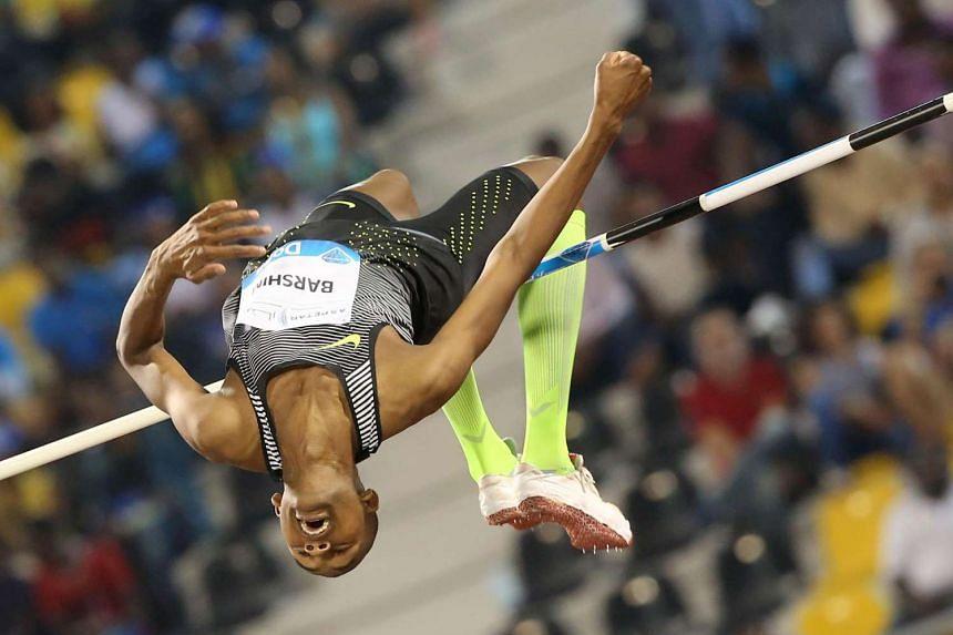 Qatar's Mutaz Essa Barshim competes in the High Jump final event at the Diamond League athletics meeting at the Suhaim bin Hamad Stadium in Doha on May 6.