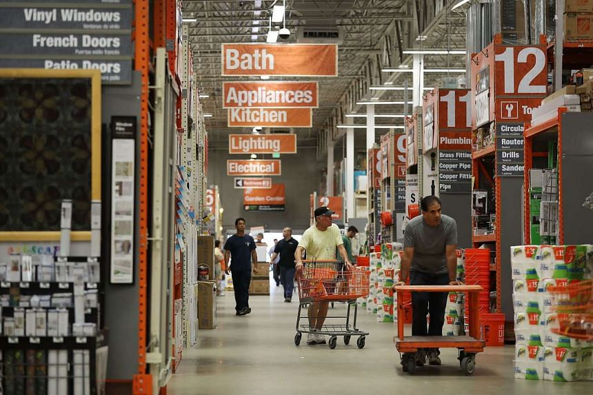 Customers shop in a Home Depot store in Florida on May 17, 2016.