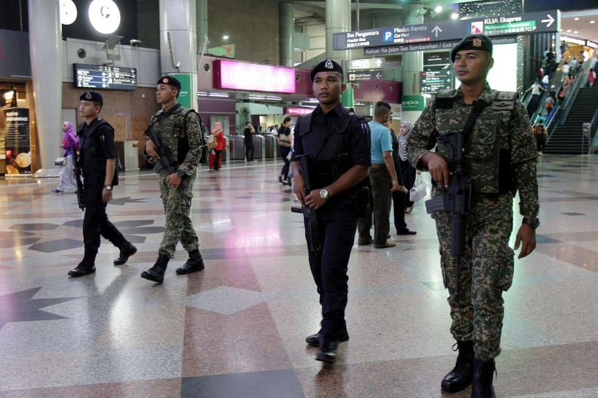 Police and army officers patrolling at Kuala Lumpur Sentral railway station amid the tighter security measures.