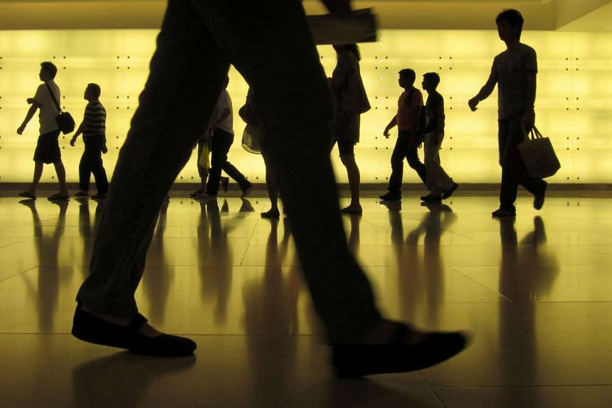 People walk through the ION shopping centre in Orchard Road in Singapore.