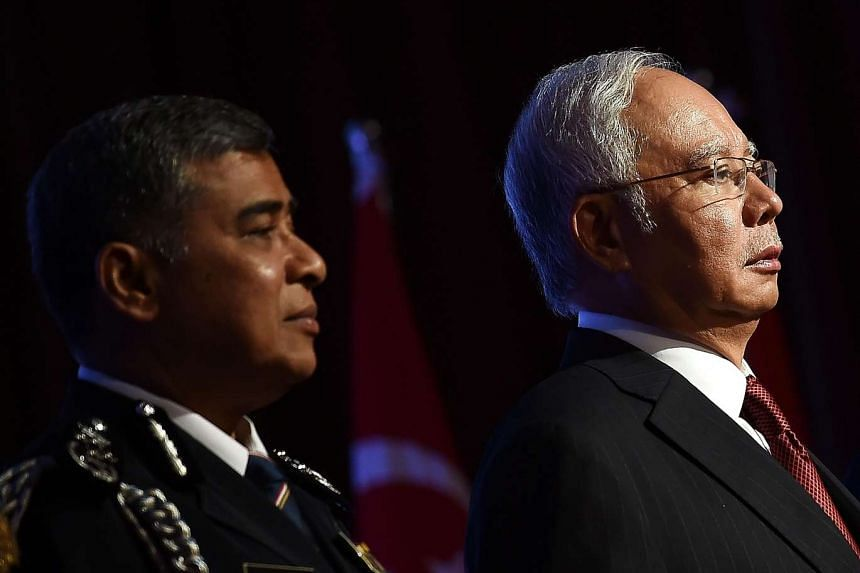 Malaysia's Prime Minister Najib Razak (right) and national police chief Khalid Abu Bakar attend the opening session of the 36th Asean Chiefs of Police Conference in Putrajaya.