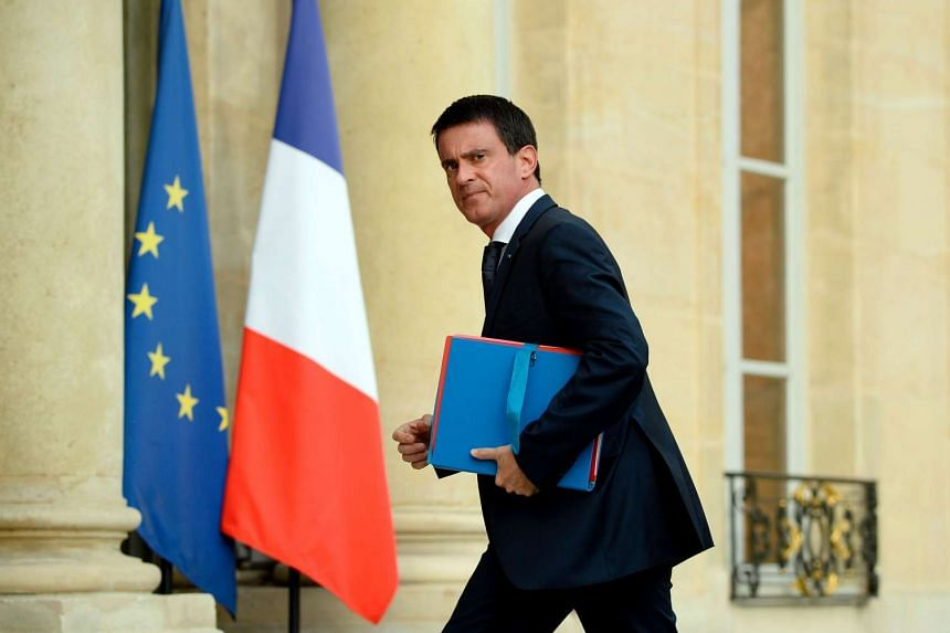 French Prime Minister Manuel Valls arrives at the Elysee Palace in Paris on July 27 for a meeting with French President and French representatives of the different religion following yesterday attack at a church in Saint-Etienne-Du-Rouveray.