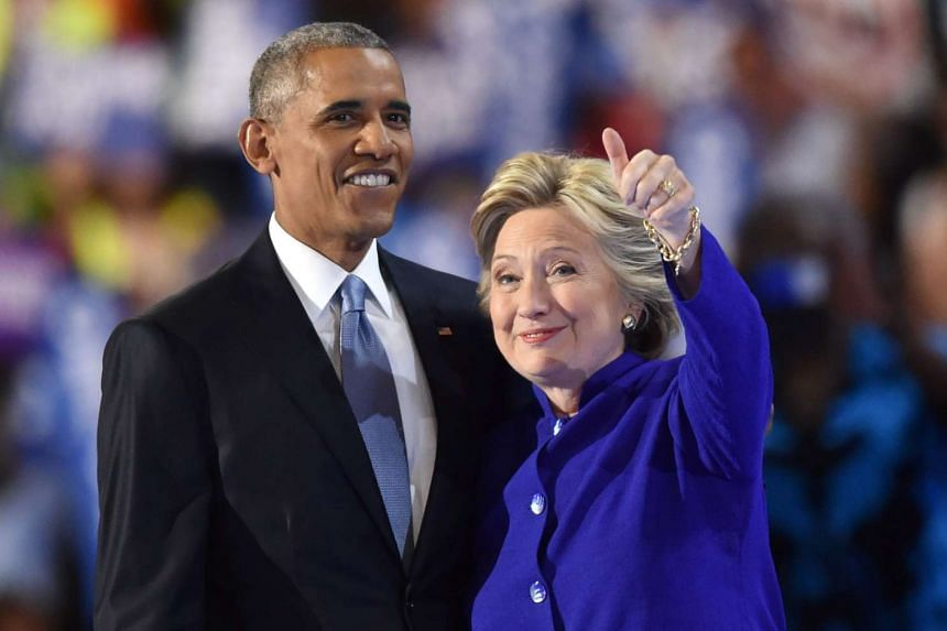 US President Barack Obama and US Presidential nominee Hillary Clinton onstage at the Democratic convention on July 27, 2016.
