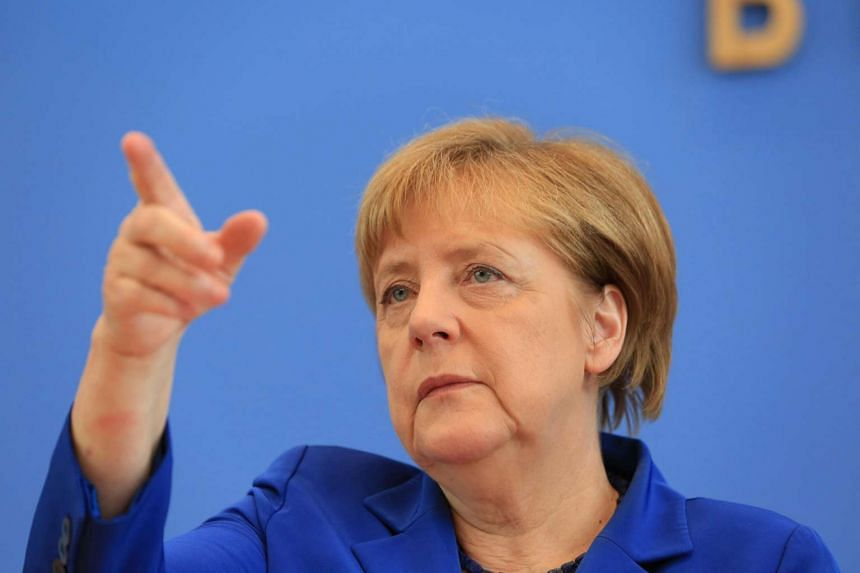 German Chancellor Angela Merkel gestures during a news conference in Berlin on July 28.