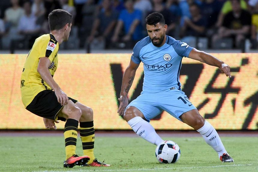 Manchester City's Sergio Aguero (right) controls the ball during the 2016 International Champions Cup football match between Manchester City and Borussia Dortmund in Shenzhen, south China's Guangdong province on July 28.