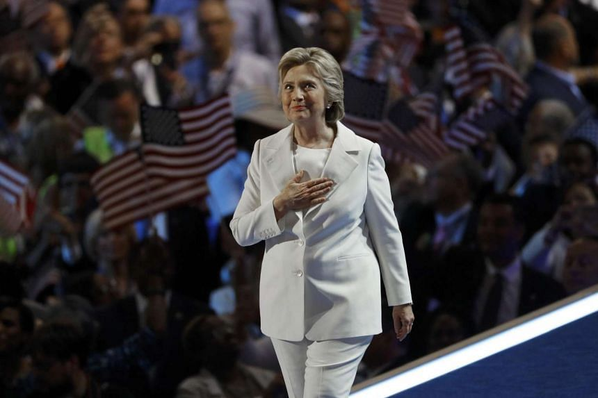 Democratic presidential nominee Hillary Clinton reacts on stage at the Democratic National Convention in Philadelphia, Pennsylvania, on July 28.