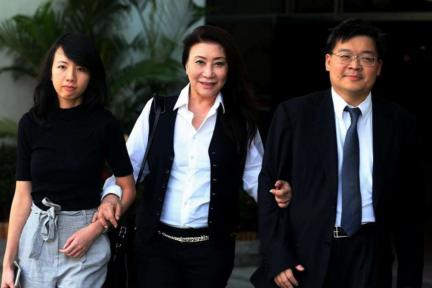 (Left to right) Lawyer Melissa Kor, Shi Ka Yee and her Lawyer lrving Choh are seen leaving the State Courts.