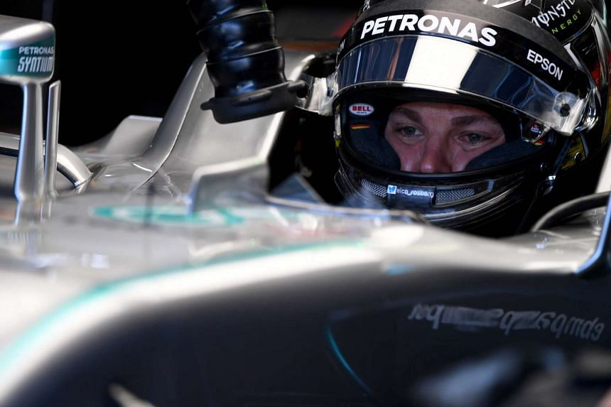 Nico Rosberg gets ready in the garage for the first practice session of the F1 German Grand Prix at the Hockenheim circuit, on July 29, 2016.