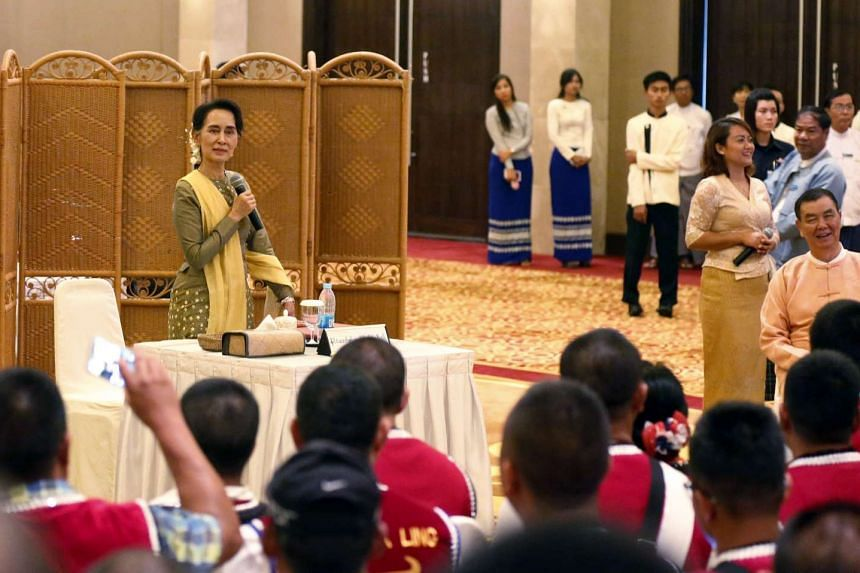Myanmar State Counsellor Aung San Suu Kyi speaks to representatives of the Wa and Mailar ethnic regions in Naypyitaw, on July 29, 2016.