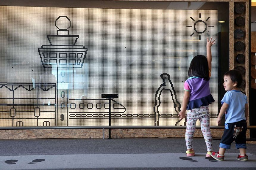 Children try out the interactive Motion Silhouette Wall in the transit hall at Changi Airport, on July 29, 2016.
