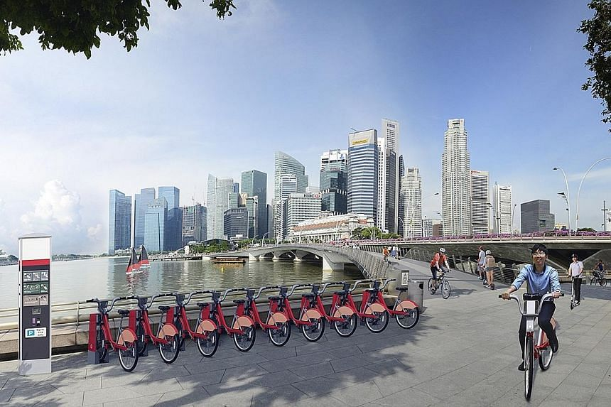 An artist's impression of the proposed bicycle-sharing infrastructure in Marina Bay-City Centre. The LTA said that whether the bicycle-sharing scheme will expand beyond the Jurong Lake District depends on the quality of the proposals it is asking for