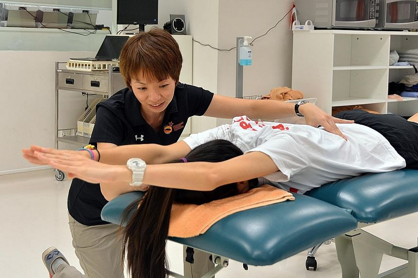 Top: Senior sports physiotherapist Yeo Hwee Koon (left) is one of 18 staff members who will be at the Singapore House in Rio de Janeiro. They will offer holistic care for 25 Singapore athletes during the Olympics - the Republic's joint-largest contin