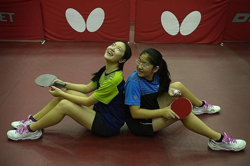 Tay Hui Wen (left), 15, has her sister's back during the table tennis competition. Hui Xin, 13, is competing in an international meet for the first time and is able to lean on her more experienced sibling.