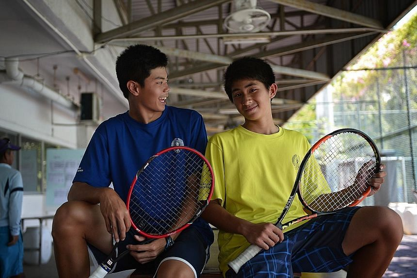 Brothers and tennis players Jeremy (left), 16, and Jerall Yasin, 13, prefer to play singles rather than doubles. But they still spur each other on.