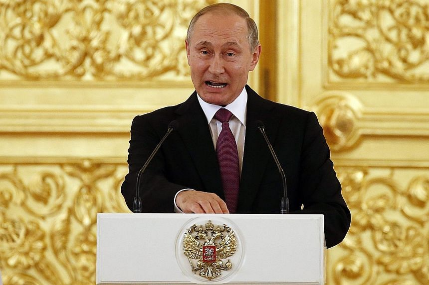 Russian President Vladimir Putin making a defiant speech in the Kremlin, saying the decision to ban Russian athletes was without basis and politically motivated.