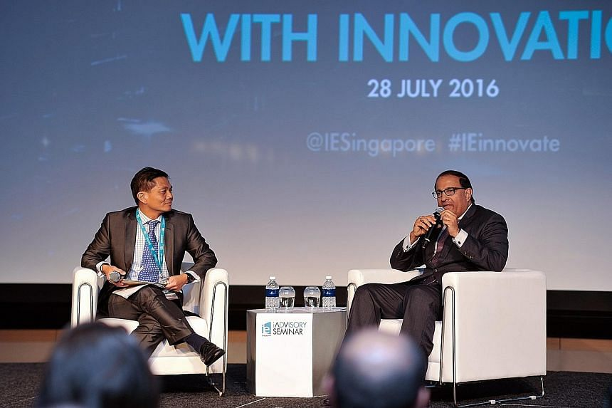Mr Iswaran at the IE Singapore seminar with moderator Ang Ser Keng, senior lecturer in finance at the Lee Kong Chian School of Business, Singapore Management University.