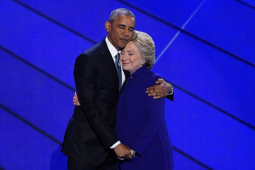 Mr Obama and Mrs Clinton, his bitter rival for the Democratic presidential nomination eight years ago, embracing each other on Wednesday.