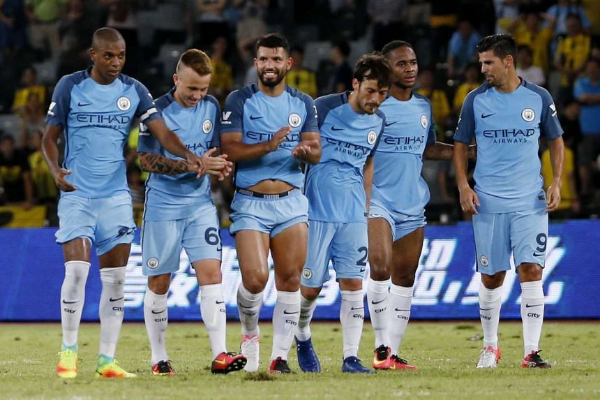 Manchester City's Sergio Aguero (centre) celebrates with team mates at the end of the match.