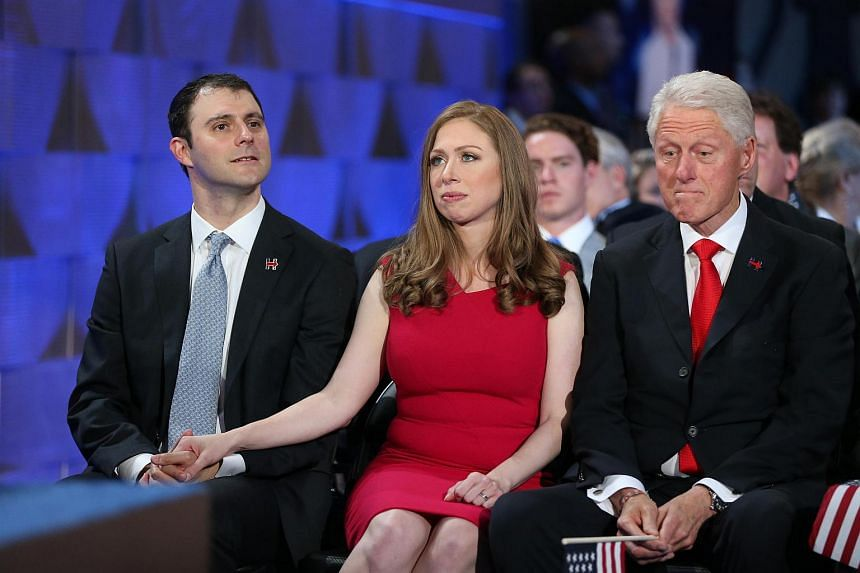 Former US president Bill Clinton, from right, Chelsea Clinton, daughter of 2016 Democratic Nominee Hillary Clinton, and her husband Marc Mezvinsky listen during the Democratic National Convention (DNC) in Philadelphia, Pennsylvania, US, on July 28.