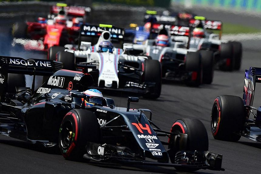 McLaren Honda's Spanish driver Fernando Alonso races at the Hungaroring circuit in Budapest on July 24.