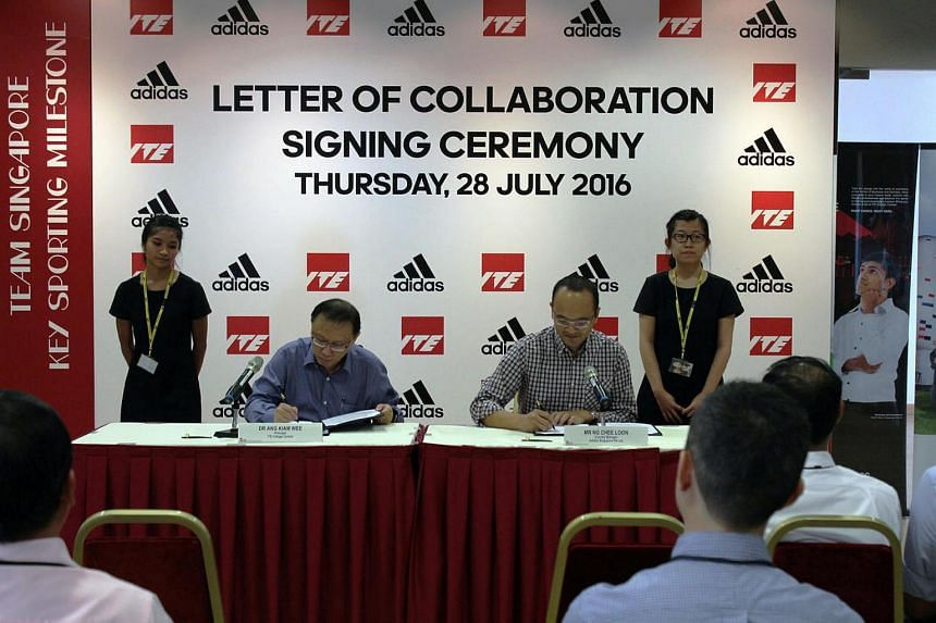 Dr Ang Kiam Wee (left), principal of ITE College Central, and Ng Chee Loon (right), Adidas country manager, ink a five-year ITE-Adidas partnership to groom talented students in sports.