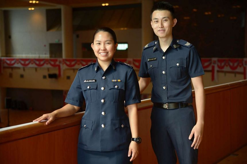 Sgt Lee Chee Guan (right) and Chief Warder (2) Nur Hannah Wang at the MHA Sponsorship Presentation Ceremony on July 29, 2016.