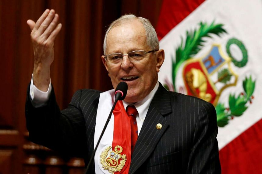 Peru's President Pedro Pablo Kuczynski gestures while addressing the audience after receiving the presidential sash.
