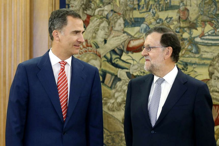 Spain's King Felipe (left) talks with acting Prime Minister Mariano Rajoy before their meeting on July 28, 2016.