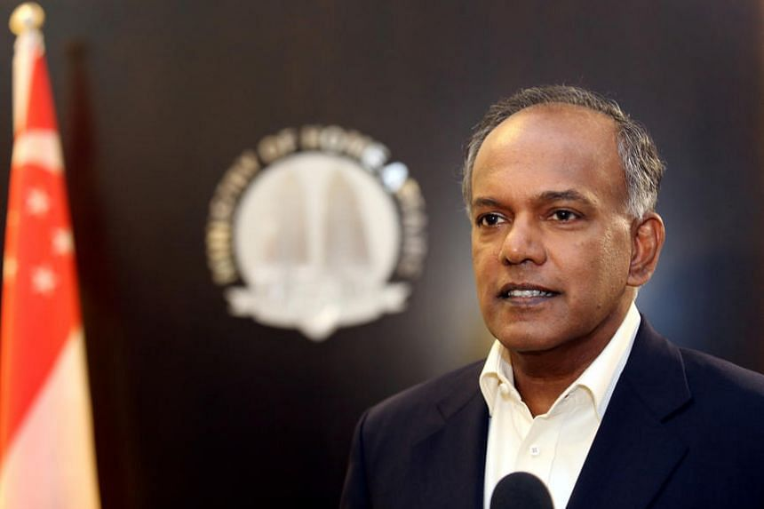 Minister Shanmugam reacts during the door stop on the arrest.